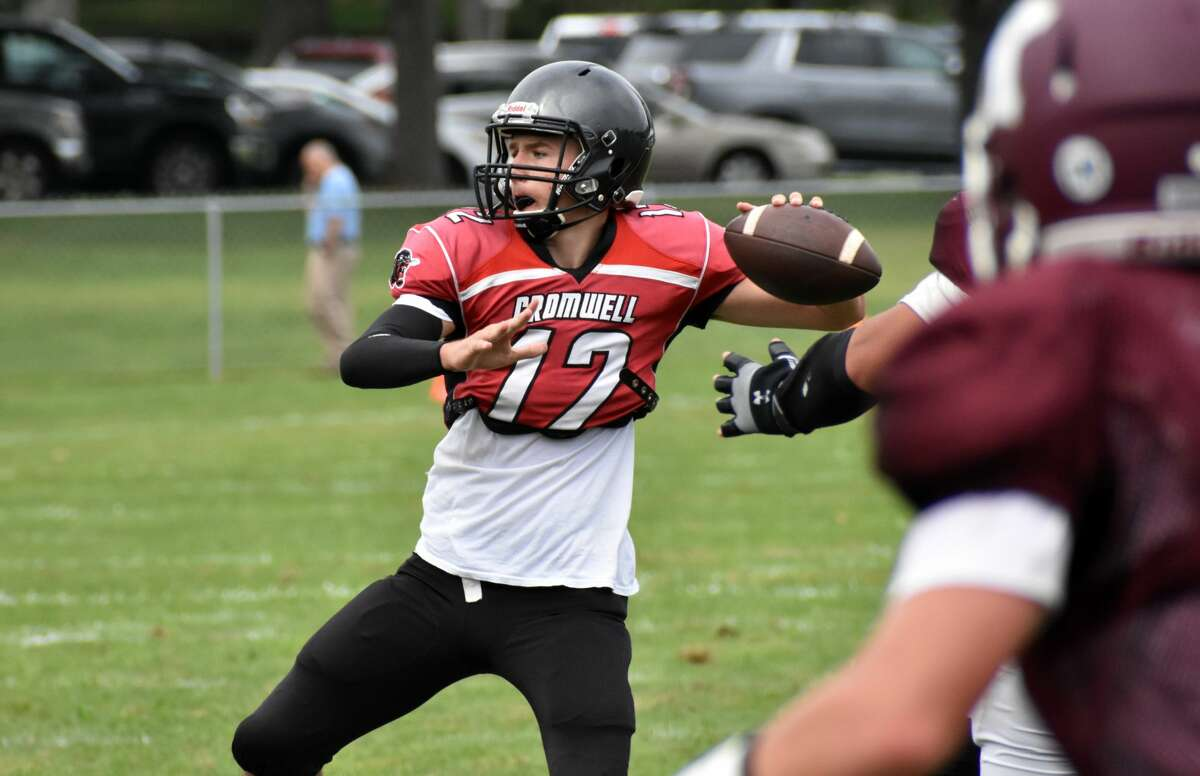 Cromwell/Portland quarterback Cole Brisson throws a pass during a quad football scrimmage at Pierson Park, Cromwell on Saturday, Aug. 28, 2021.