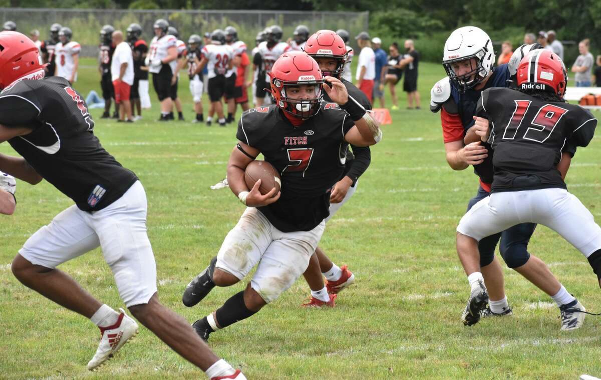Fitch's Greg Santora runs the ball during a quad football scrimmage at Pierson Park, Cromwell on Saturday, Aug. 28, 2021.