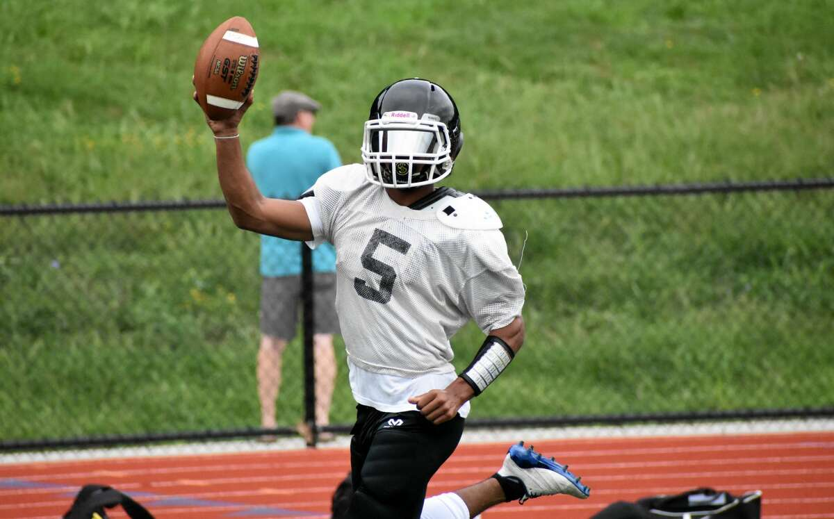 SMSA co-op's Danny Hernandez celebrates scoring a touchdown during a quad football scrimmage at Platt High, Meriden on Saturday, Aug. 28, 2021. (Pete Paguaga, Hearst Connecticut Media)