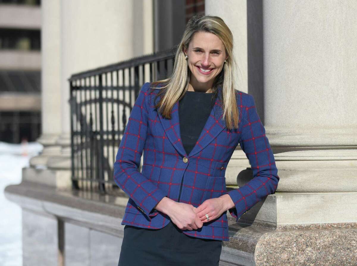 State. Rep. Caroline Simmons, D-Stamford, poses in downtown Stamford, Conn. Wednesday, Feb. 10, 2021. Simmons, a representative of the state's 144th District for the last six years, is one of two candidates running for mayor against incumbent David Martin.