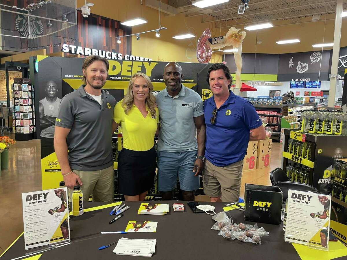 From left: DEFY founders Eric Frohardt, Megan Bushell and Terrell Davis and DEFY president Beau Wehrle celebrate the launch of their products in Katy on Aug. 26, 2021.