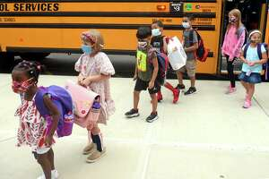 Students arrive for the first day of class at Jefferson Elementary School, on the Ponus Ridge STEAM Academy campus in Norwalk, Conn. Aug. 30, 2021.