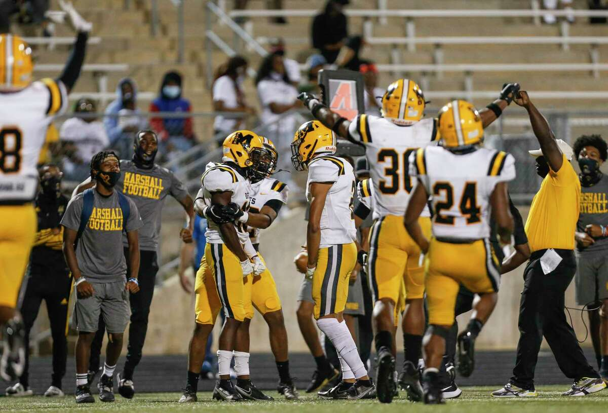 Fort Bend Marshall defensive back Chris Stephens (10) celebrates after deflecting a pass in the end zone as time ran out at Kenneth Hall Stadium Thursday, Oct. 1, 2020, in Missouri City , Texas. The play gave Fort Bend the 7-0 win.