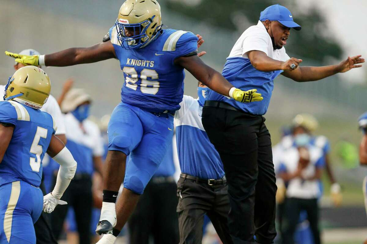 Elkins Knights linebacker Daron Smith (26) celebrates on the sidelines after recovering a fumble against Fort Bend Marshall, during the first half of the game at Kenneth Hall Stadium on Thursday, Oct. 1, 2020, in Missouri City , Texas.