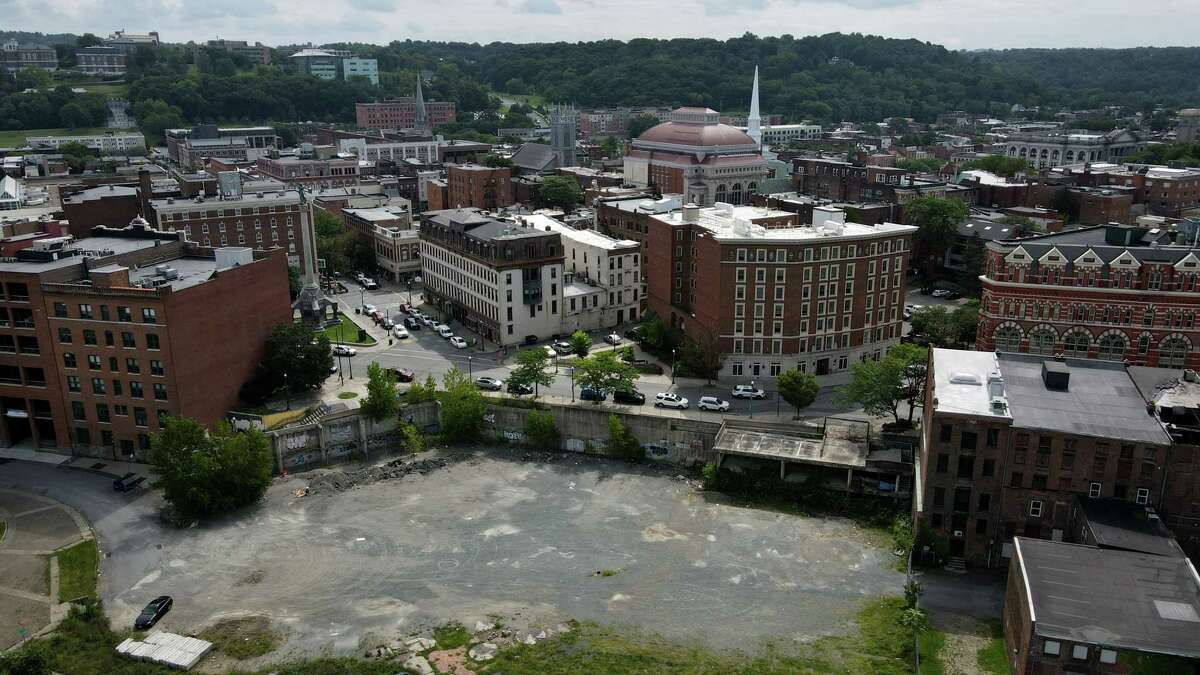 The vacant lot at 1 Monument Square where City Hall once stood on Monday, Aug. 30, 2021, in Troy, N.Y. A public meeting is planned for Sept. 9 on proposals for development of the site.