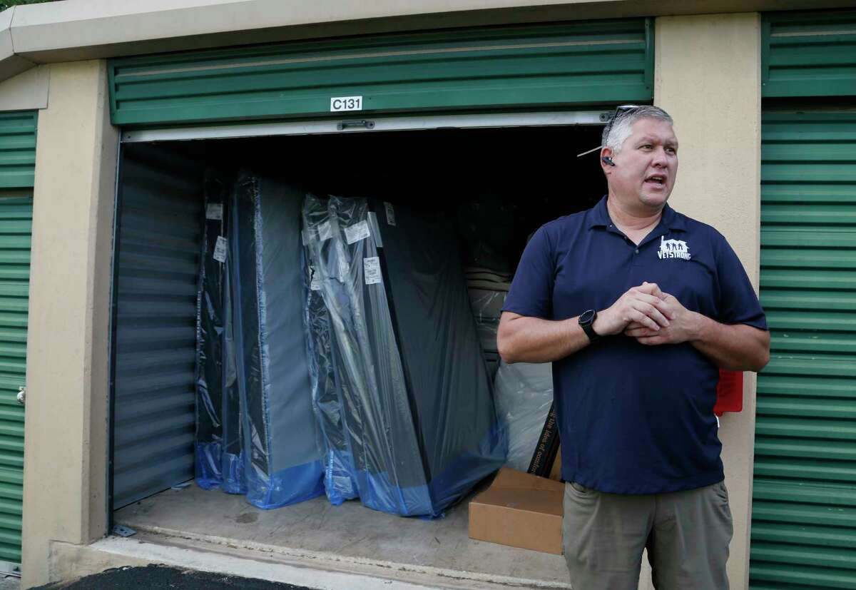VetStrong founder and Afghanistan veteran James Pobanz waits for other veterans at a warehouse beds and furniture are stored on Saturday, Aug. 28, 2021. The beds and furniture will be delivered to the Wurzbach Manor apartments.