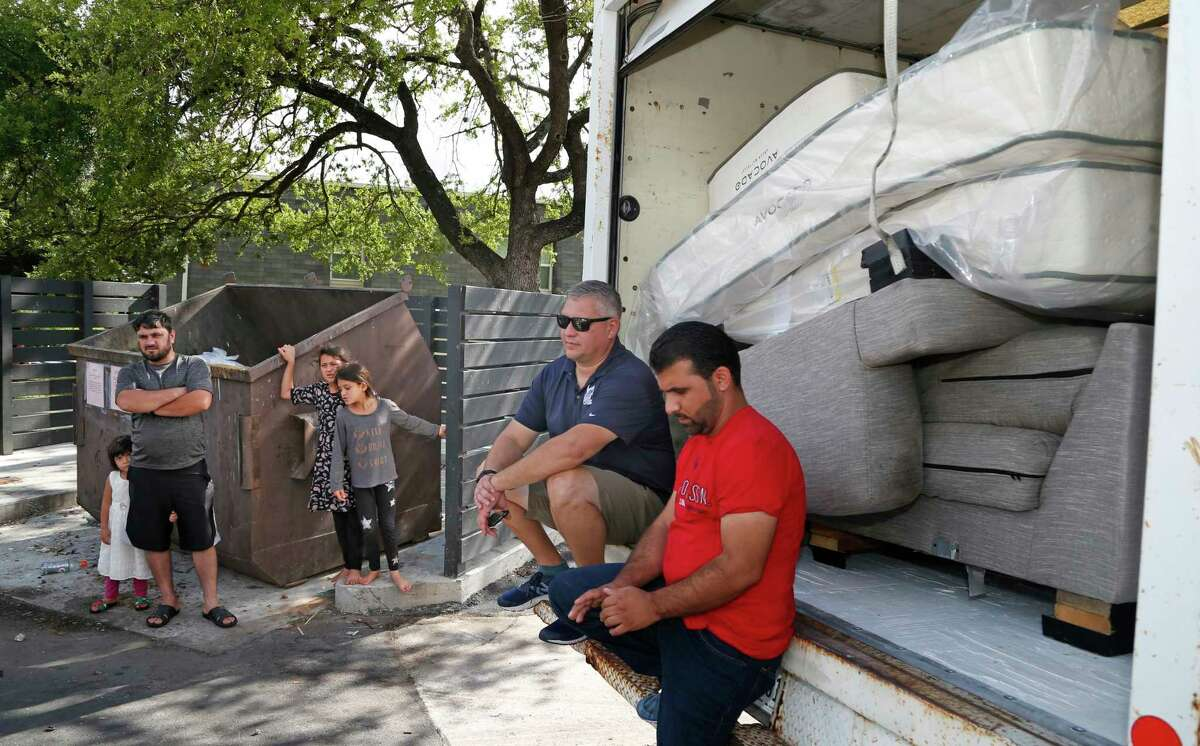 VetStrong founder and Afghanistan War veteran James Pobanz waits for information to know what apartments will be getting beds at Wurzbach Manor apartments on Saturday, Aug. 28, 2021. Waiting with Pobanz is Mohammad Khan.