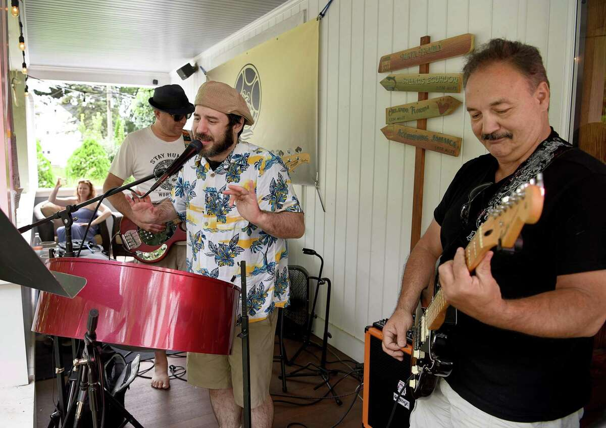 From left, Pedro Mato, Brian Ente and Randy Lauro of the Standard Banana Band, perform in Black Rock Porchfest Saturday.