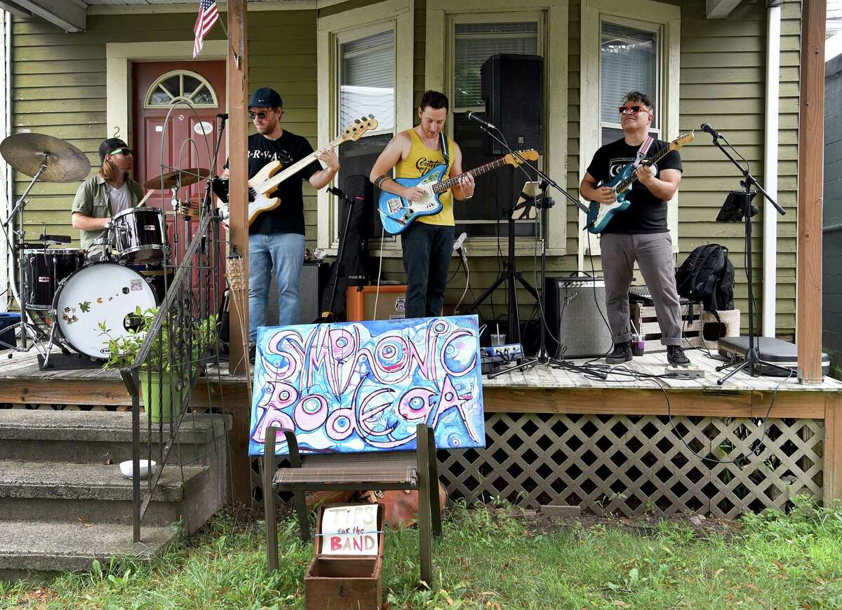 The Symphonic Bodega Band from Bridgeport, perform in Black Rock Porchfest on Saturday. The members are from left, Kenny Owens, Alex Swift, Mike Colavolpe and Christopher Cavaliere. The event featured local bands performing on various home porches along several streets in the Black Rock section of Bridgeport.