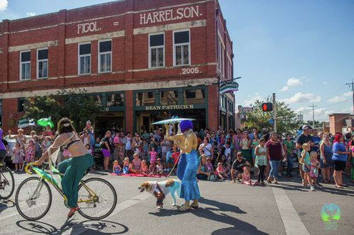 Parade marchers delight crowds in downtown San Marcos at the 2019 Mermaid Promenade, part of the annual Mermaid Capital of Texas Fest.