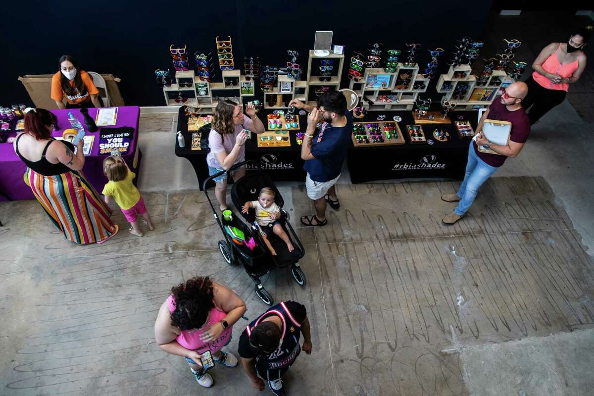 People shop at the Railway Heights Market during the soft opening, Saturday, Aug. 21, 2021, in Houston.