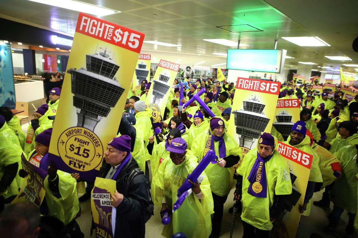 FILE - Airport workers protest for a $15 minimum wage in Newark, N.J., Nov. 29, 2016. Richard Trumka's 12 years as AFL-CIO president coincided with the continued decline of organized labor but also moments of opportunity, like the election of a devoutly pro-labor U.S. president. With Trumka's death last week, the federation faces a fundamental question: What is the AFL-CIO's purpose? (Chang W. Lee/The New York Times)
