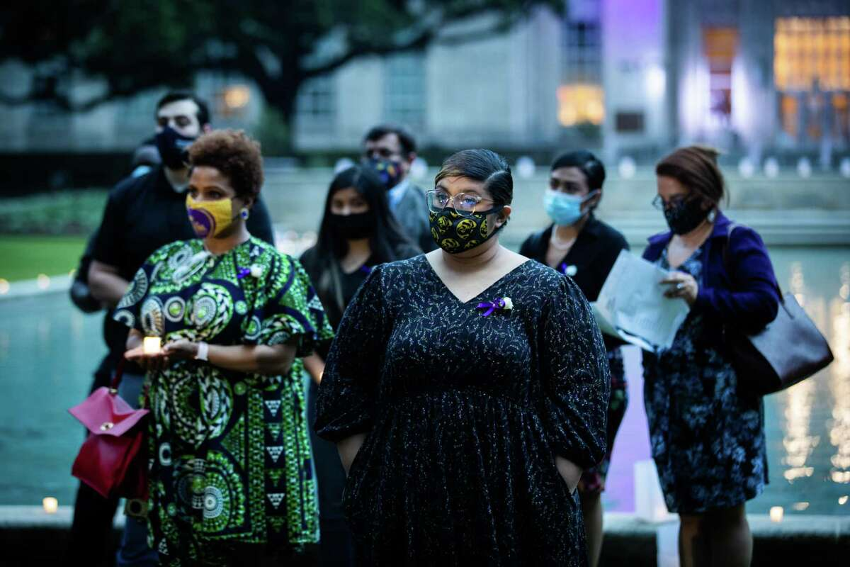 International Union of Painters and Allied Trades' Bianca Castro surrounded by other members of the labor movement attended a vigil during the Workers Memorial Day 2021, Wednesday, April 28, 2021, in Houston. During the vigil the attendants remembered those who have died in preventable workplace incidents.