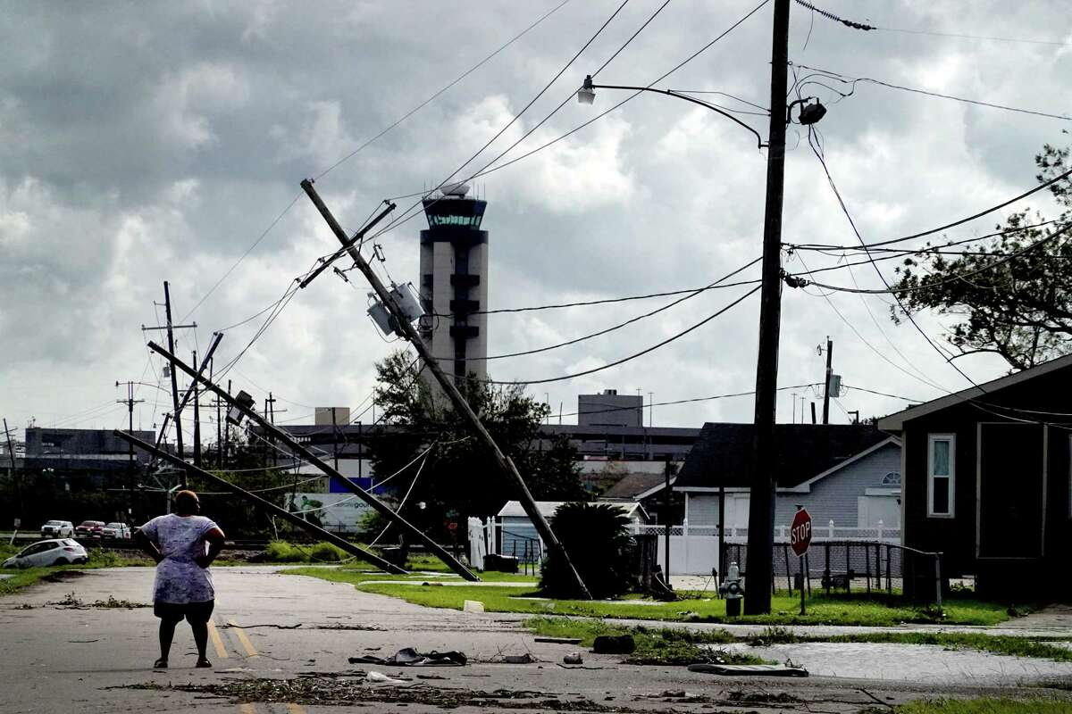 A woman looks over damage to a neighborhood caused by Hurricane Ida on Monday, August 30, 2021 in Kenner, Louisiana. Ida made landfall yesterday as a Category 4 storm southwest of New Orleans.