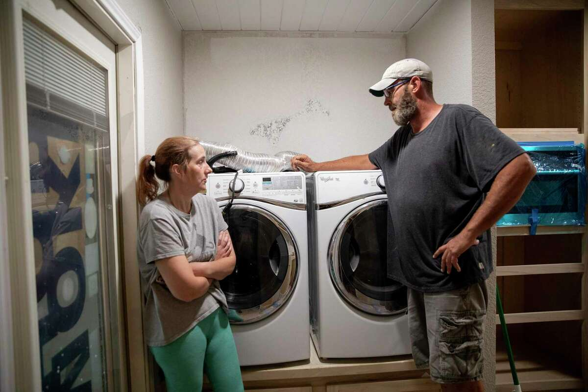 James and Ann Creasman go over their plans for the next day as they get ready to begin moving into the back rooms of their home.