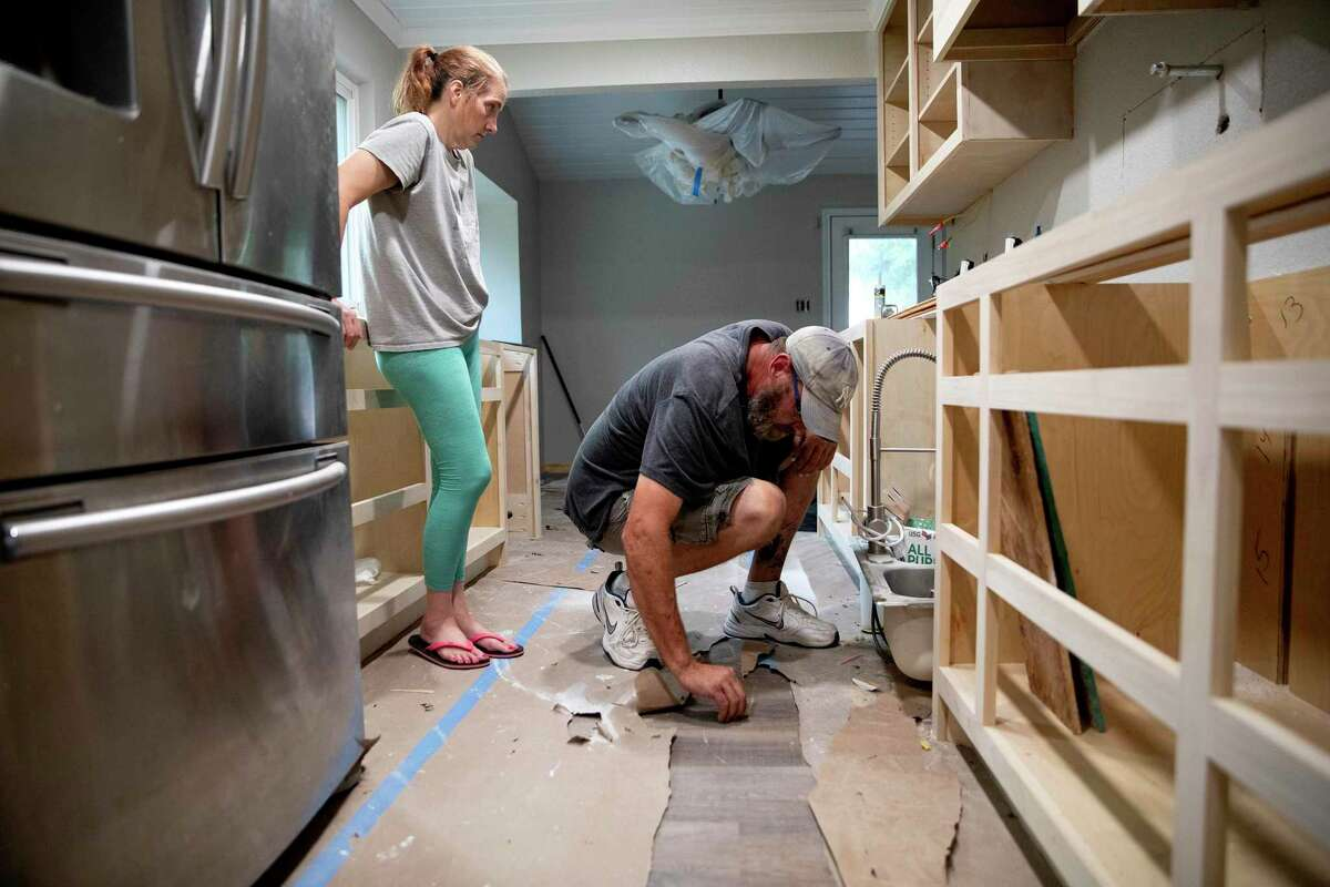 James and Ann Creasman inspect the work of the contracts in their kitchen. Much of the interior of their home was destroyed in July due to flash flooding.