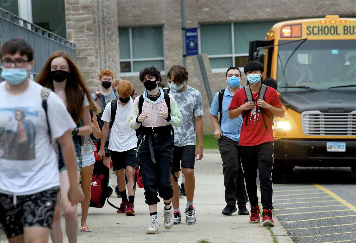 Students arrive for the first day of school at Fairfield Ludlowe High School in Fairfield, Conn. on Aug. 30, 2021.