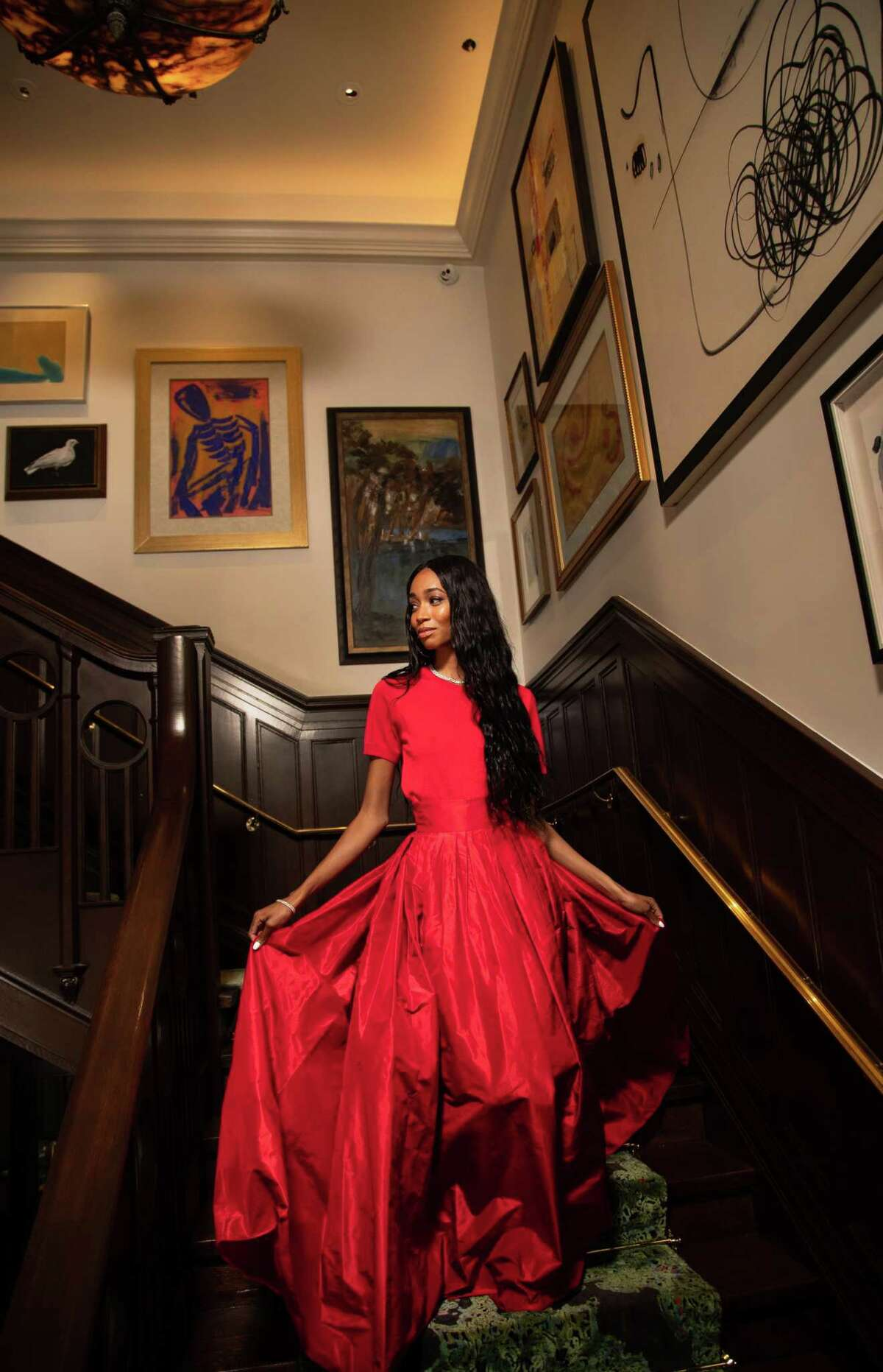 Jordin Williams wears a Carolina Herrera knit blouse, $690, and ball skirt, $2,390, from Saks Fifth Avenue, diamond hoop earrings, $45,000, chain link diamond necklace, $49,500, chain link diamond bracelet, $7,950, and diamond cocktail ring, $22,500, from Valobra Master Jewelers Tuesday, July 13, 2021, in Houston.