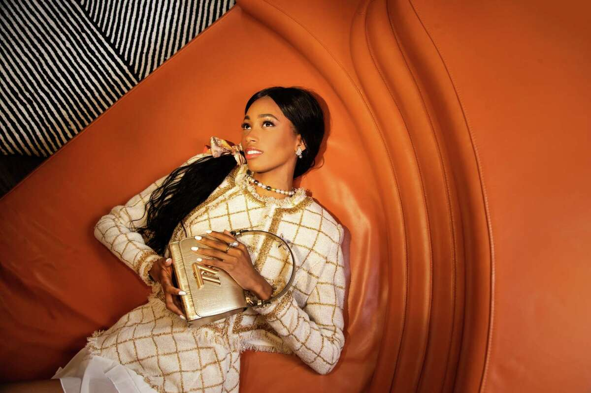 Jordin Williams wears an Oscar de la Renta embroidered Lurex tweed jacket, $3,490, and dress, $3,890, Louis Vuitton Twist PM handbag, $3,000, and Hermes scarf, $125, from Vintage Contessa, diamond and pearl earrings, $18,000, South Sea pearls necklace, $4,200, Mikimoto flower brooch, $5,000, and diamond and pearl ring, $7,000, from Shaftel Diamonds Tuesday, July 13, 2021, in Houston.