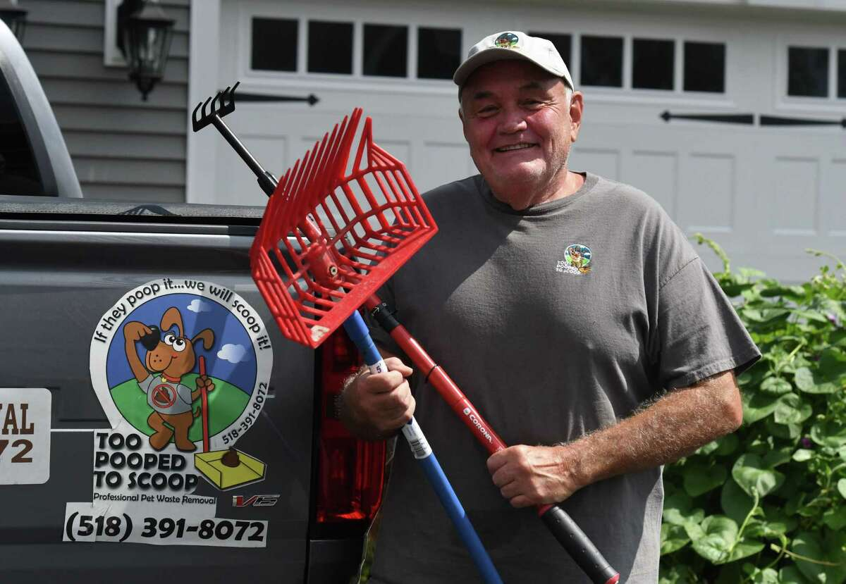 Jon Weidman, founder of Too Poop to Scoop, a local business where he and his employees scoop dog poop for people on Monday, Aug. 30, 2021, in Glenmont, N.Y.