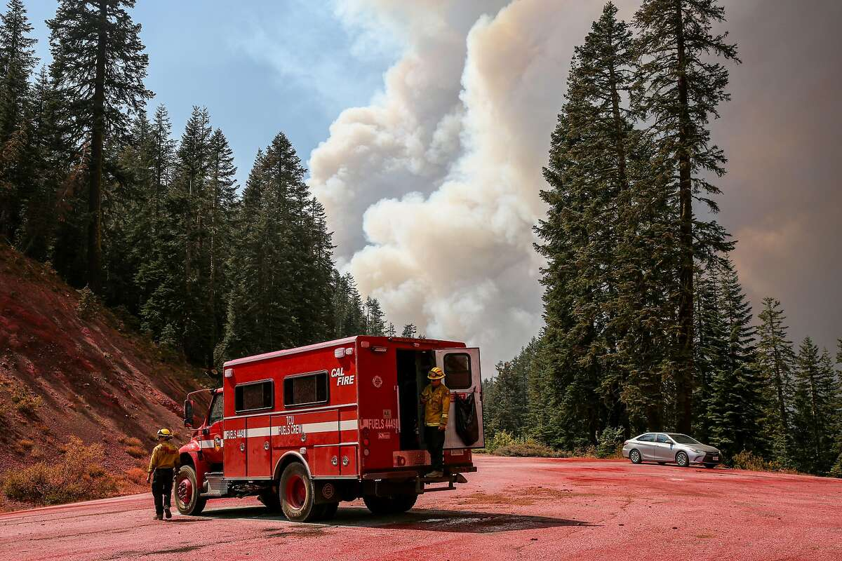 Covered in fire retardant, a Cal Fire truck can be seen on Mormon Emigrant Trail near Leek Spring Hill, Calif. on Sunday, Aug. 29, 2021. The fire retardant was used to control flames a part of the Caldor Fire barrier south of Lake Tahoe.