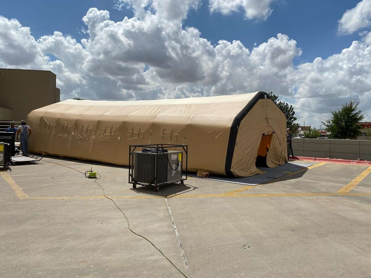 A tent from the state has arrived at Midland Memorial to help with the number of patients arriving at the ER.