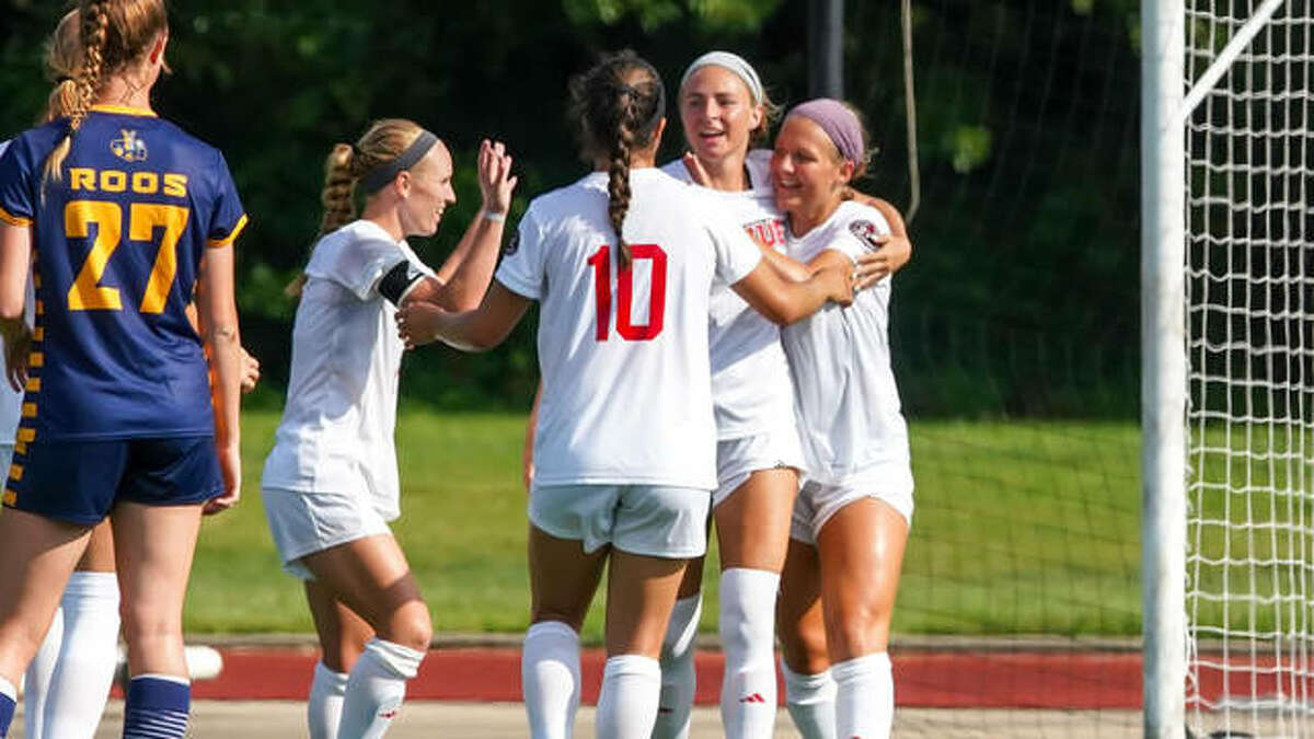 Members of the SIUE women's soccer team celebrate after scoring a goal in Sunday's win over Kansas City.