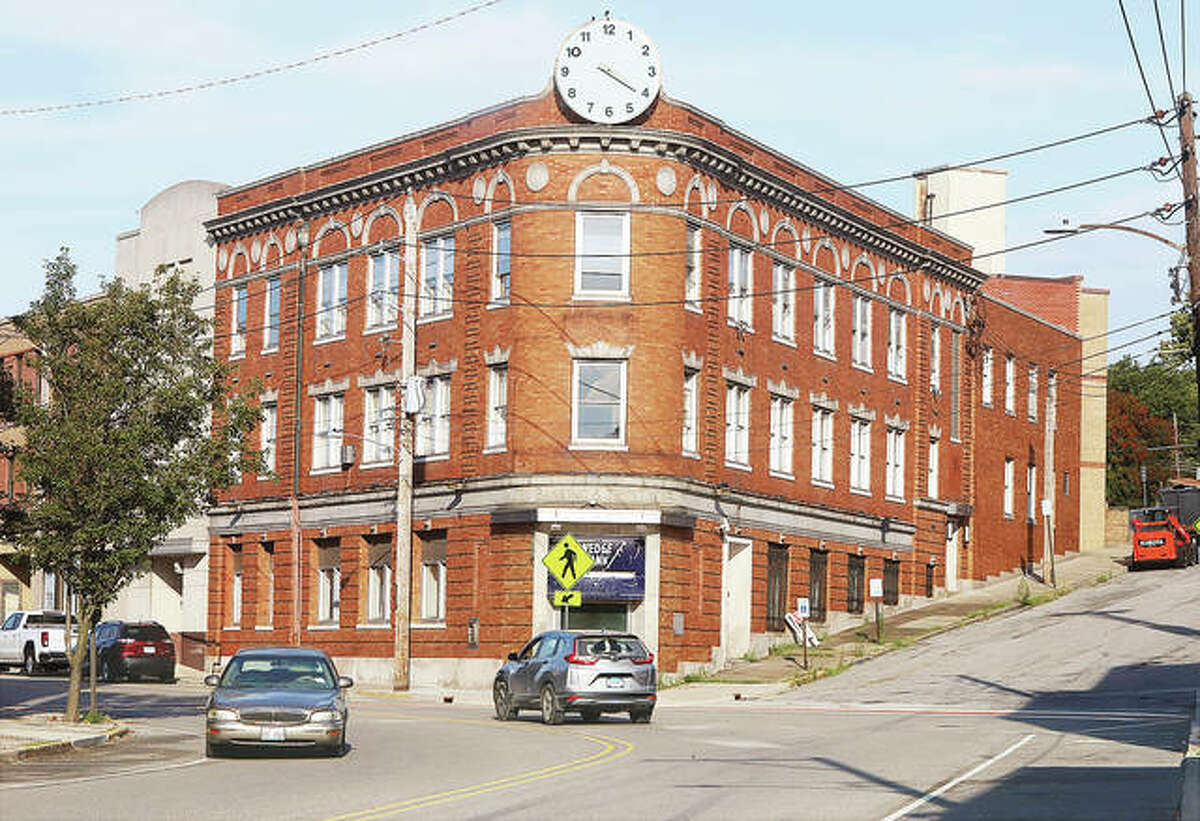 Traffic passes the landmark Wedge Building Monday in the 600 block of East Broadway. Pat McGinnis of AltonWorks says the group is nearing an announcement of a proposed business incubator in the iconic building. - John Badman|The Telegraph