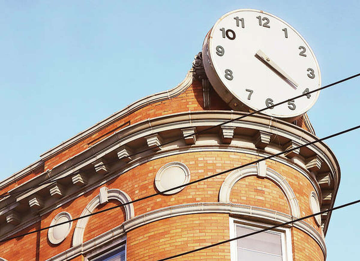 """The curved point of the """"wedge"""" has a nonfunctional clock erected long after the building was complete. Behind it is the original clock, which has been covered for decades. AltonWorks is developing plans to create a business incubator in the building for """"startups with social impact"""". - John Badman