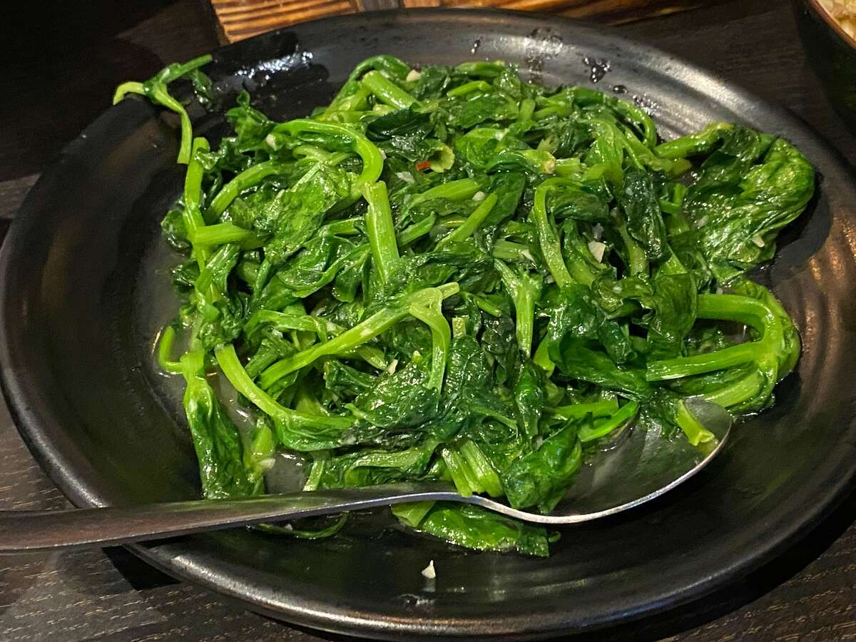 Pea shoots sauteed in garlic at Spices Restaurant on Aug. 28, 2021.