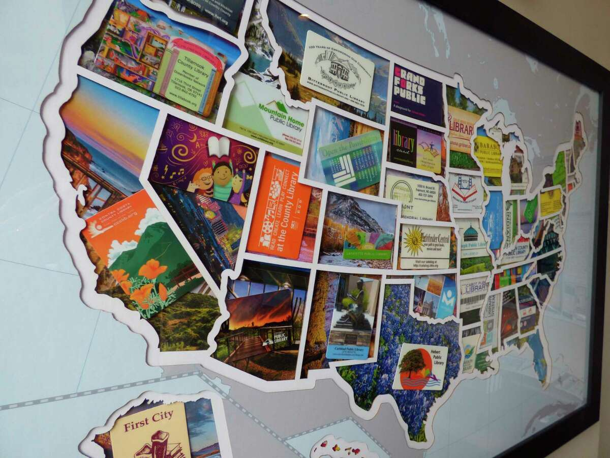 A collage showcasing library cards gathered from all 50 states will be on display at each of the library's six branches in September. (Scott Fraley/News Advocate)