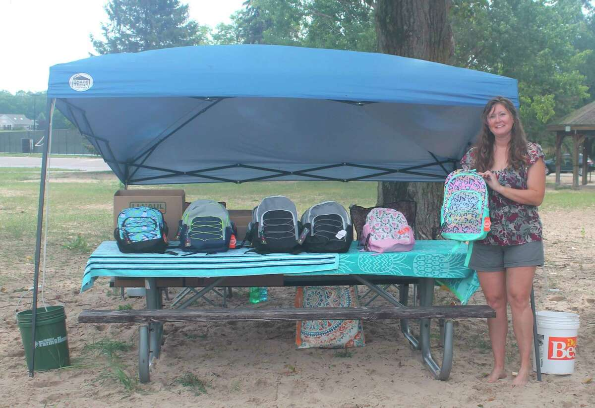 Danyal Blakeslee, of Manistee, gave out nearly 90 backpacks and sets of school supplies at First Street Beach Sunday to local children. Blakeslee started a backpack and school supplies drive with her sons so Manistee County students could start the school year with everything they needed. (Kyle Kotecki/News Advocate)