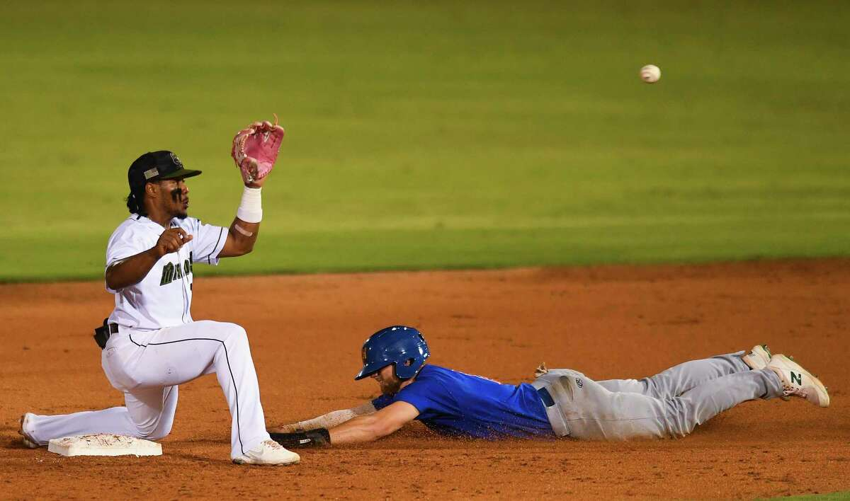 Eguy Rosario of the San Antonio Missionds receives the throw as Max Schuemann of the Midland Rockhounds steals second base during minor league baseball action at Wolff Stadium on Wednesday, Aug. 25, 2021.