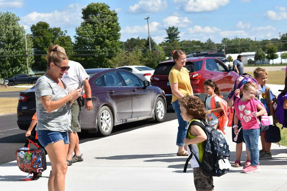 On Monday, students at Chippewa Hills School District's Barryton Elementary School were talking and laughing waiting in groups organized by class, and were met by excited parents during pickup at the end of the first day of the school year.
