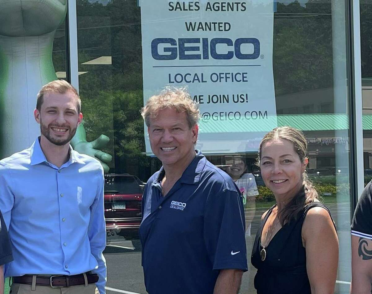 Mark and Lori Fields, along with Geico agent Brian Moynihan, at the insurer's new office at 572 Main Ave. in Norwalk, Conn.