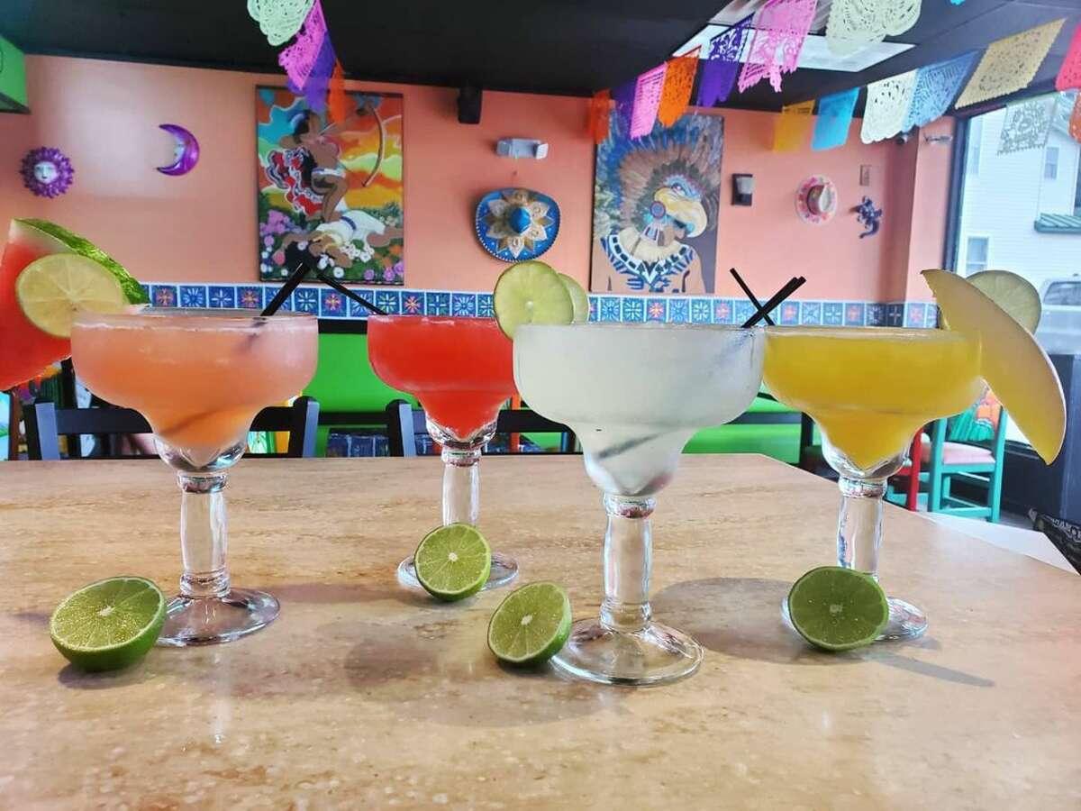 Guac Taco & Tequila Bar offers vegan options like a guacamole rice bowl alongside meaty favorites like carne asada - and a rainbow of margaritas.