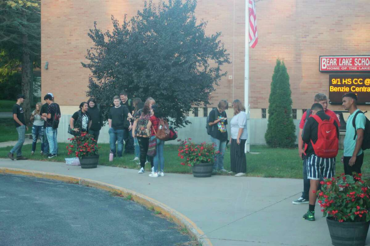 Bear Lake students catch up while waiting for a bus to go to theWexford-Missaukee Career Technical Center in Cadillac on the first day of school Monday morning. (Kyle Kotecki/News Advocate)