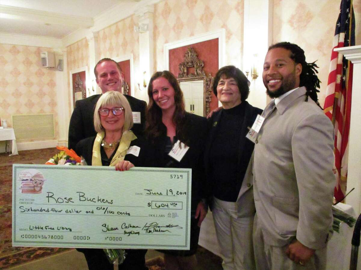 Leadership Northwest graduates are pictured in 2019 making a donation to Rose Buckens' Little Free Libraries. The leadership program, offered by the Northwest CT Chamber of Commerce, is seeking applicants for a new session that starts in October and continues monthly through June 2022.