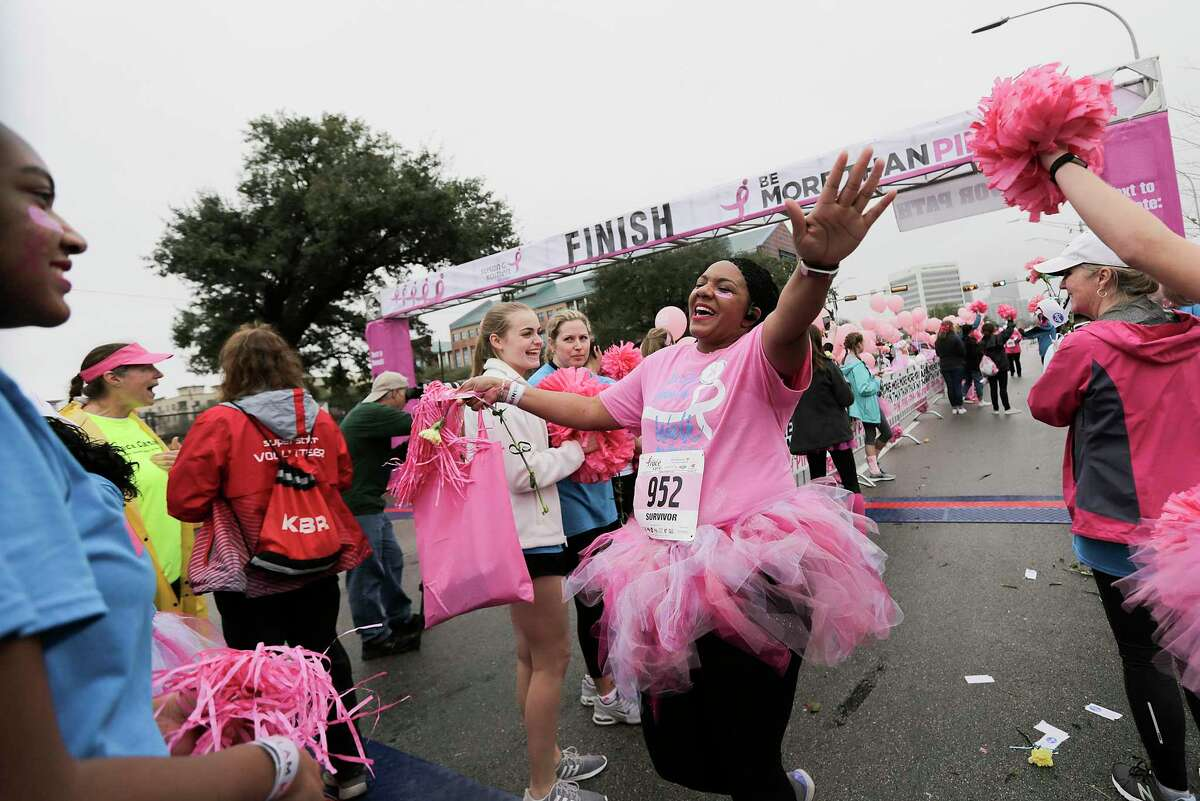 Aline Brown makes her way through the survivor's finish line during the Susan G. Koman Race for the Cure on Saturday, Jan. 27, 2018, in Houston. The event, which is traditionally in October, was rescheduled because of Harvey. ( Elizabeth Conley / Houston Chronicle )