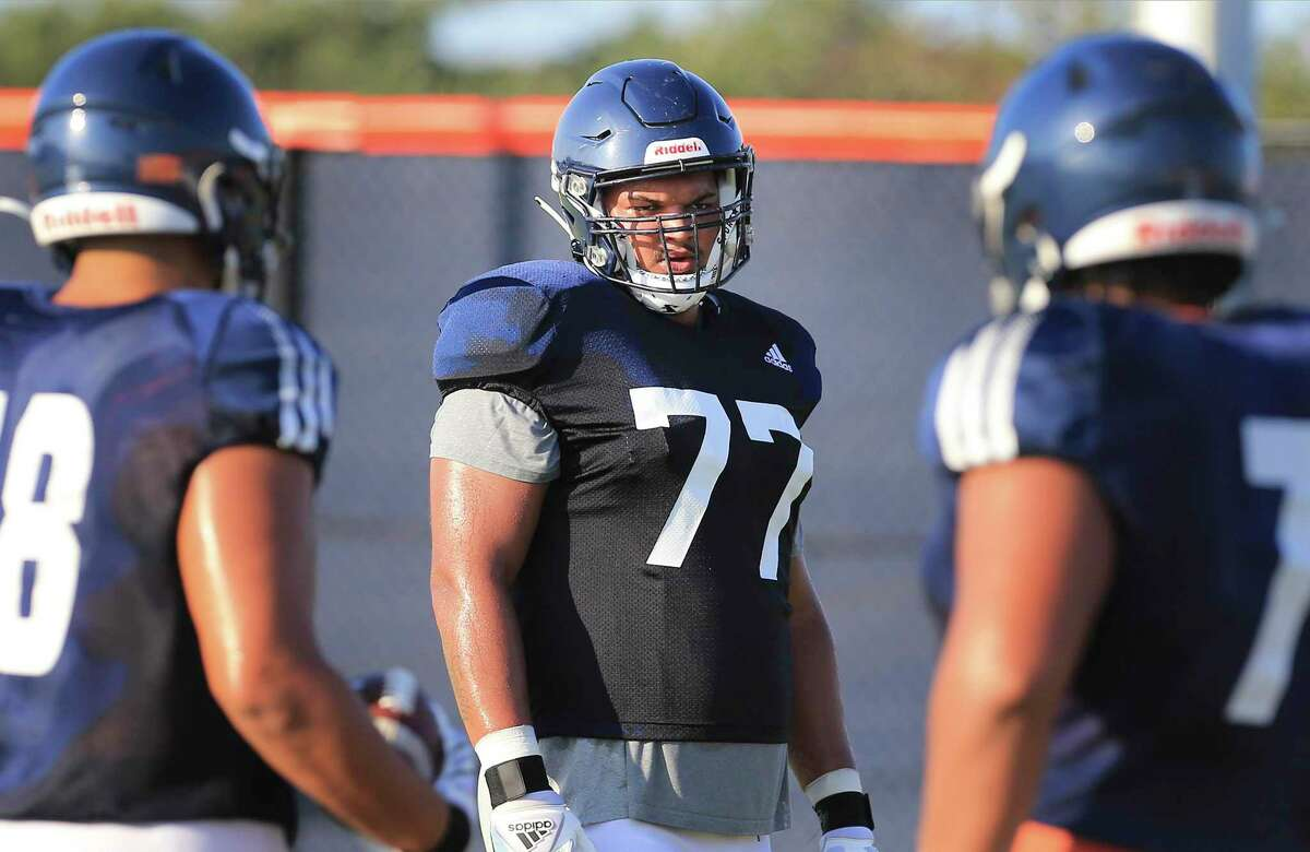 Offensive lineman Makai Hart (77) and other members of the UTSA football team takes part in practice at the school's new Roadrunner Athletics Center of Excellence (RACE) on Thursday, Aug. 26, 2021 in preparation for their first game of the season. The Roadrunners will visit and play against Illinois on Sept. 4.