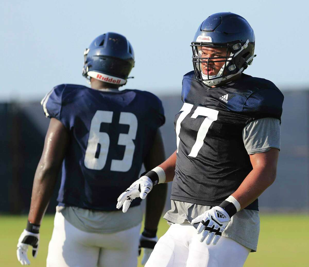 Offensive lineman Makai Hart (77) and other members of the UTSA football team take part in practice at the school's new Roadrunner Athletics Center of Excellence (RACE) on Thursday, Aug. 26, 2021 in preparation for their first game of the season. The Roadrunners will visit and play against Illinois on Sept. 4.