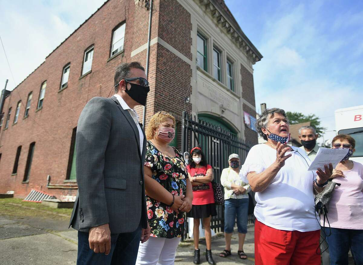 From left, Mayor Joe Ganim, city council members Aidee Nieves and Maria Valle speak during the announcement of the new East Side Senior Center at the former Fire Engine Company 10 on Putnam Street in Bridgeport, Conn. on Monday, August 30, 2021.
