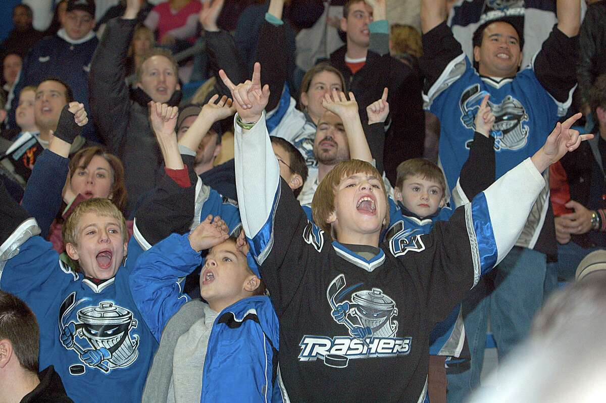 Cheering for the Trashers ice hockey team at the Danbury Ice Arena in 2005 were, left, Alex Campione, 11, right, Garrett Palmer, 10, both of New Fairfield.