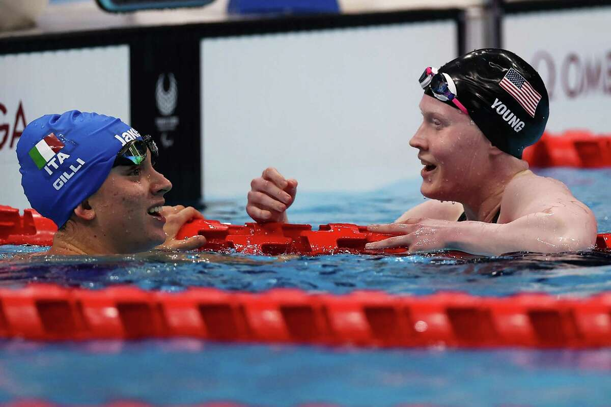 Gold-medalist Carlotta Gilli of Italy is congratulated by silver medalist Colleen Young of the United States after completing the Women's 200-meter Individual Medley-SM13 Final on day 6 of the Tokyo 2020 Paralympic Games at Tokyo Aquatics Centre on Monday.