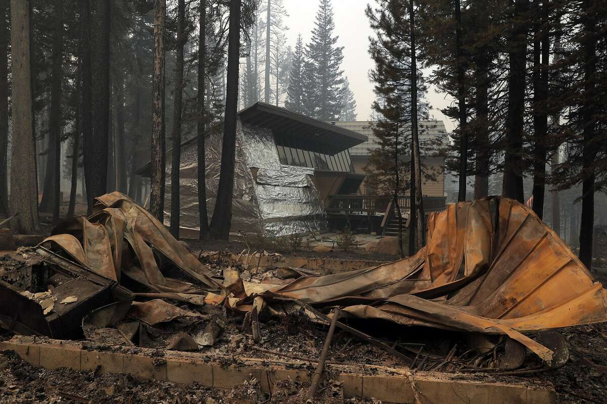 A home survived the flames after it was wrapped in foil as other structures nearby were destroyed in a residential area near Sierra At Tahoe in the devastation left by the Caldor Fire.