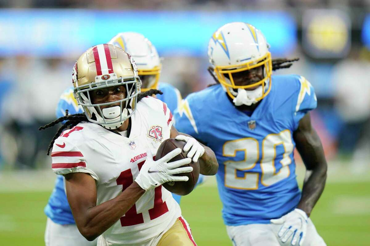 San Francisco 49ers wide receiver Travis Benjamin, left, runs into the end zone for a touchdown during the second half of a preseason NFL football game against the Los Angeles Chargers Sunday, Aug. 22, 2021, in Inglewood, Calif. (AP Photo/Jae C. Hong)