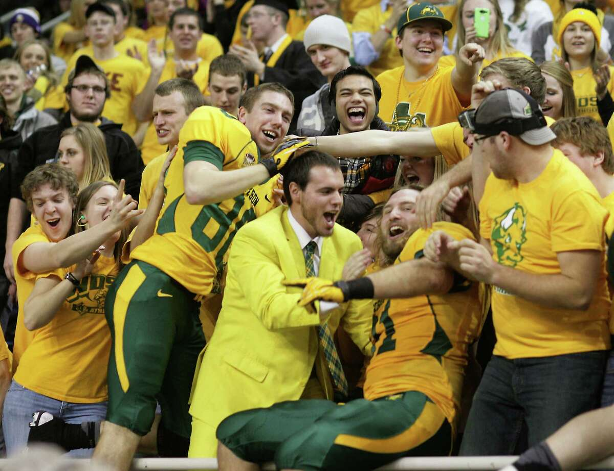 North Dakota State fans, shown here during a 2013 game, should make the Fargodome a very loud atmosphere for the University at Albany football team on Saturday. (Bruce Crummy/Associated Press)