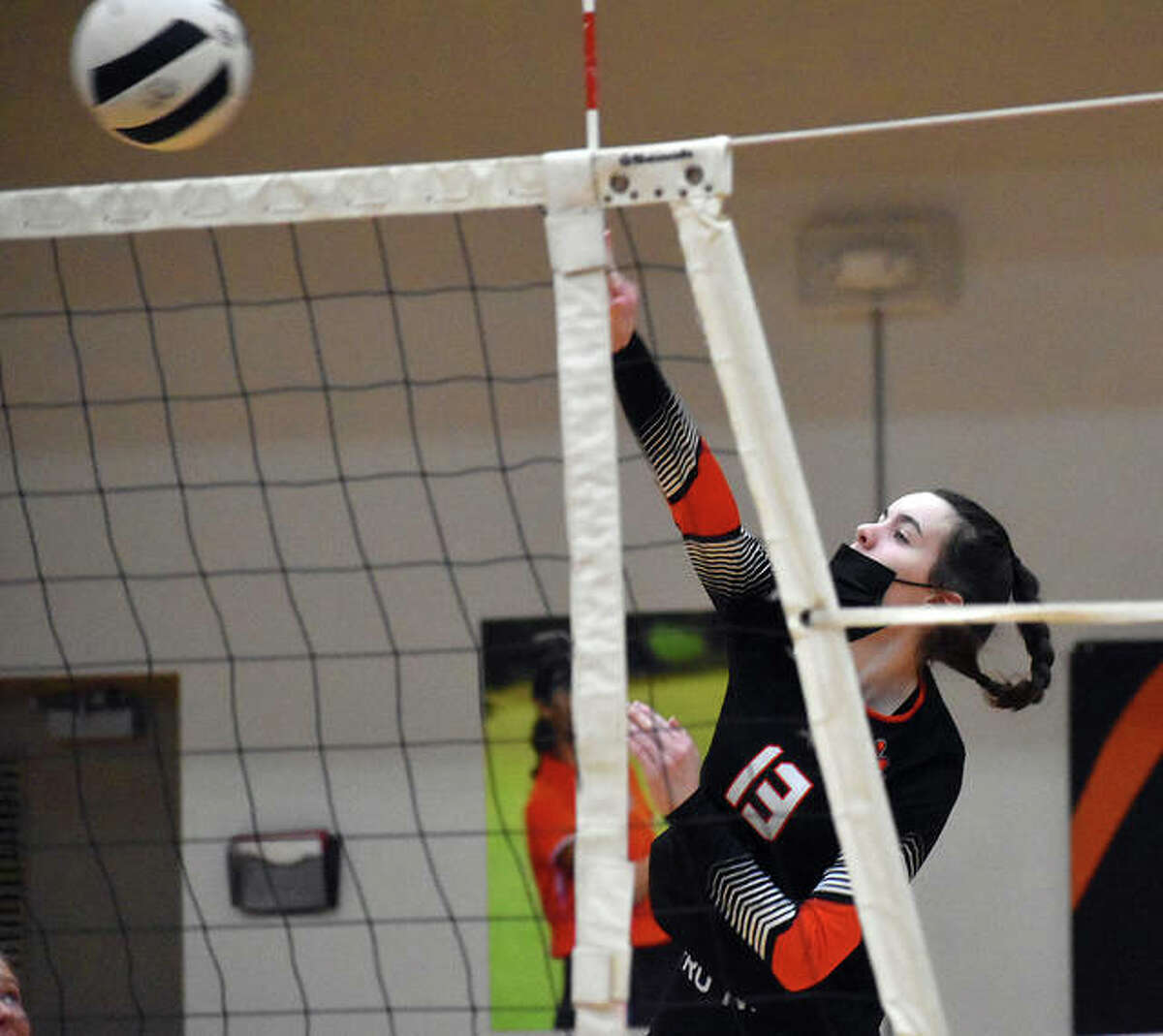 Edwardsville's Sydney Davis goes up for a kill during an SWC match last season against East St. Louis.