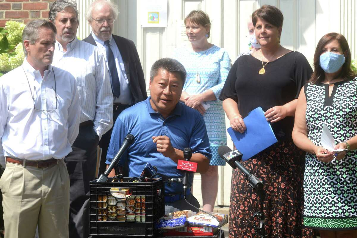 State Sen. Tony Hwang speaks during a news conference in front of Operation Hope, in Fairfield, Conn. Aug. 30, 2021.