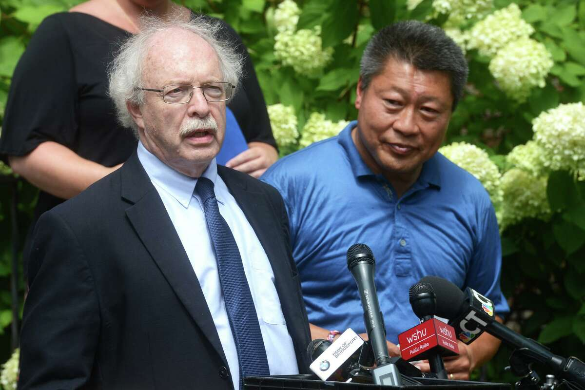 Raphael Podolsky of Connecticut Legal Services speaks as he stands with State Sen. Tony Hwang during a news conference in front of Operation Hope, in Fairfield, Conn. Aug. 30, 2021.